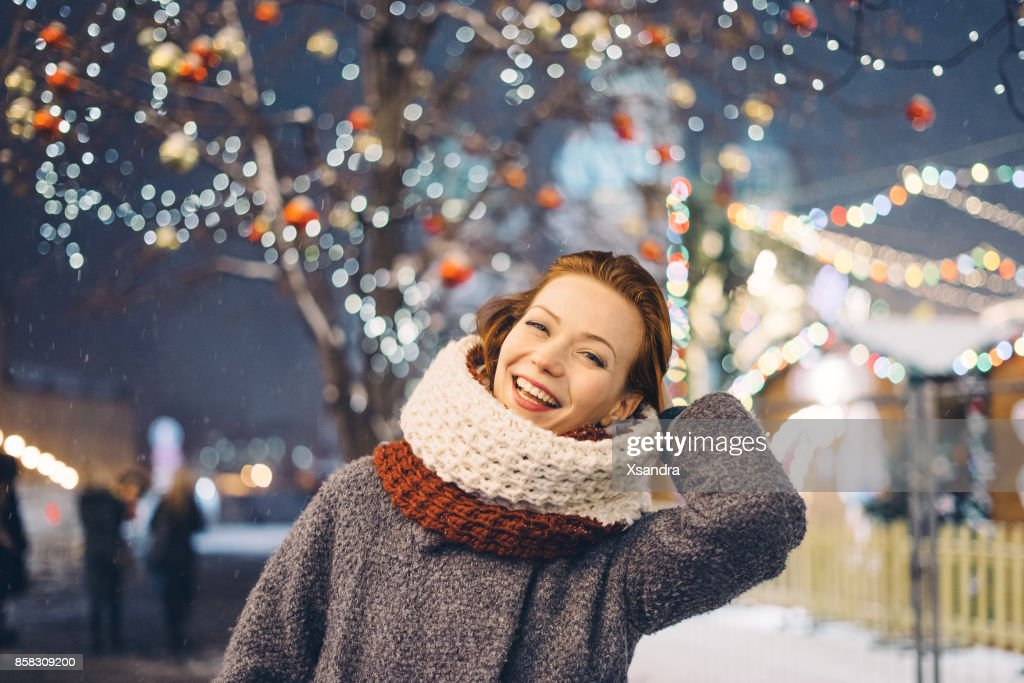 Happy woman at the Christmas market at night : Stock Photo