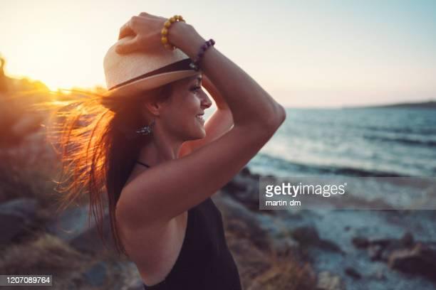 happy woman at the seaside enjoying the sunset - bulgária imagens e fotografias de stock