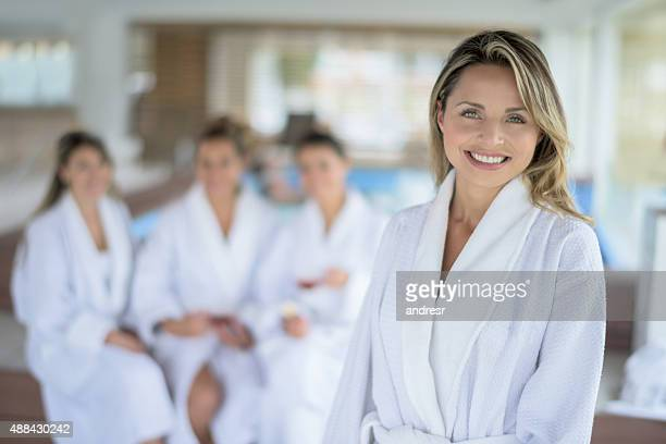 Happy woman at the spa with a group of friends