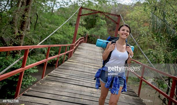 Happy woman backpacker walking outdoors