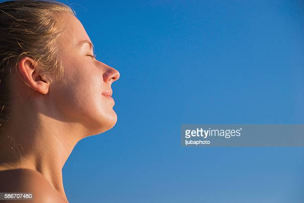 Happy woman breathing deep fresh air