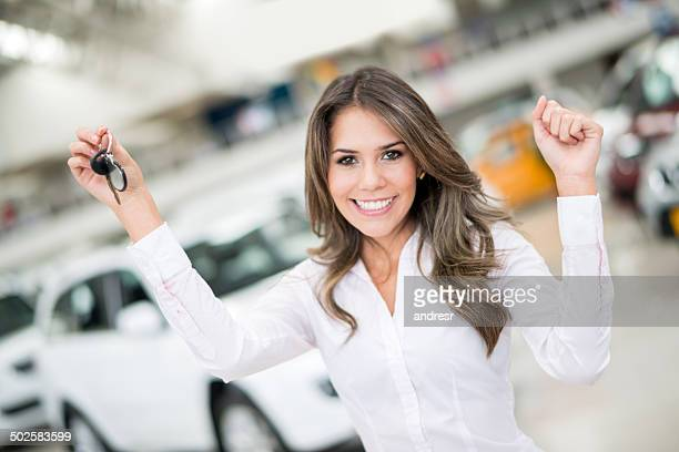 happy woman buying a car - car show stock pictures, royalty-free photos & images