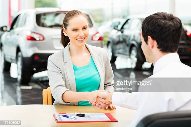 Happy Woman Buying Car