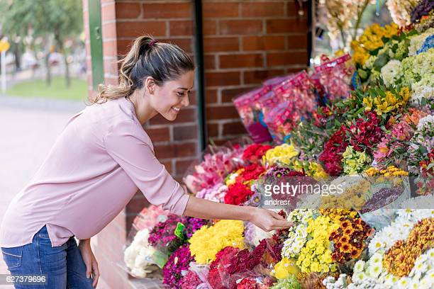 Happy woman buying flowers