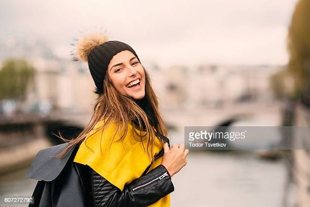 happy woman by the river - yellow hat stock pictures, royalty-free photos & images