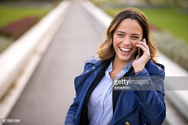 happy woman calling on smartphone