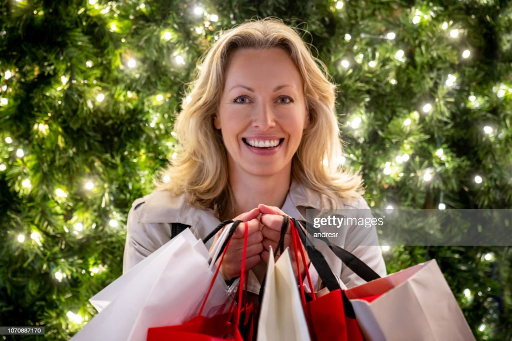 Happy woman Christmas shopping in London : Stock Photo