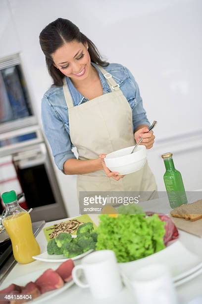 Happy woman cooking at home