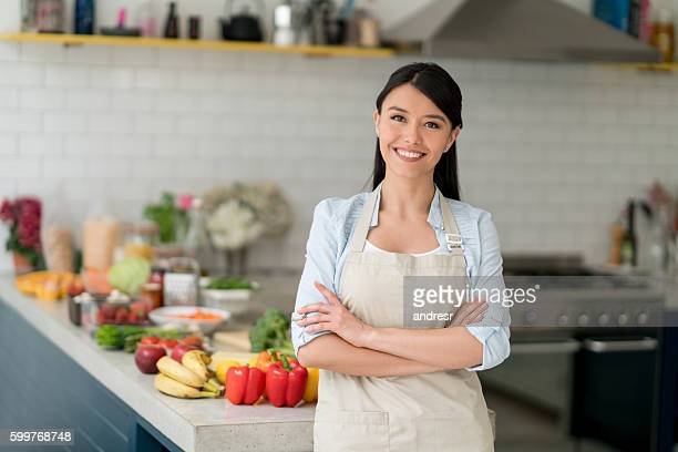 happy woman cooking at home - homemaker stock pictures, royalty-free photos & images