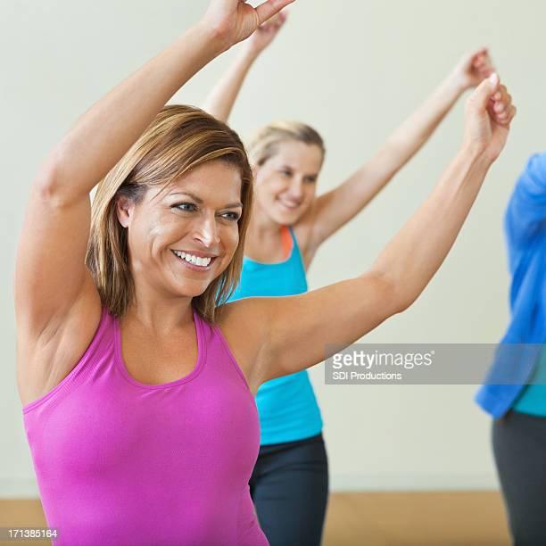 Happy woman dancing in dance fitness class