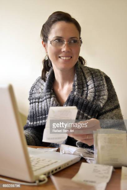 Happy woman doing accounting