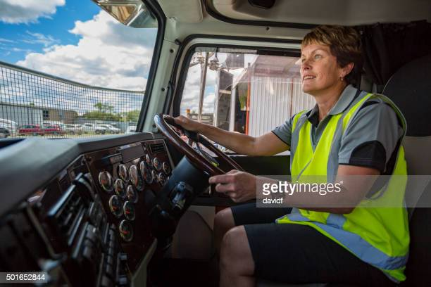 Happy Woman Driving a Truck Wearing Hi-Vis Clothes