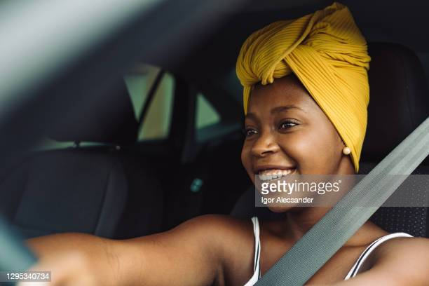 happy woman driving car - turban stock pictures, royalty-free photos & images