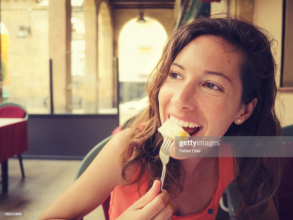 Happy woman eating some fruit : Stock Photo