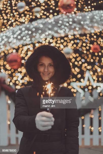 Happy woman enjoying Christmas outside
