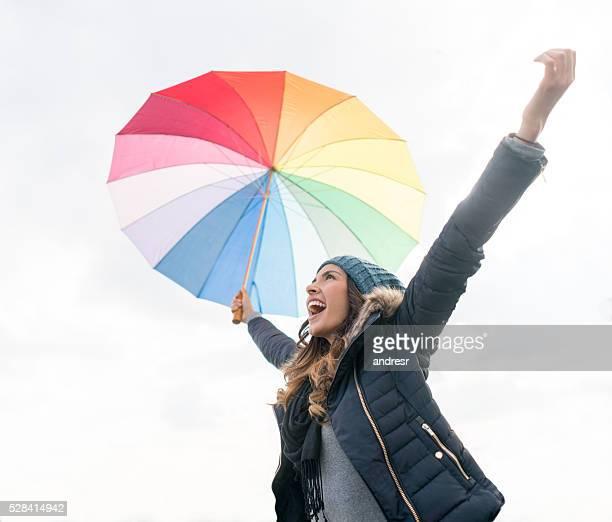 Happy woman enjoying the rain