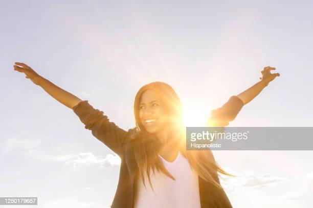 happy woman enjoying the sunshine outdoors - spirituality stock pictures, royalty-free photos & images