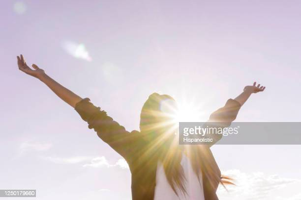 happy woman enjoying the sunshine outdoorswith opened arms - holy city stock pictures, royalty-free photos & images