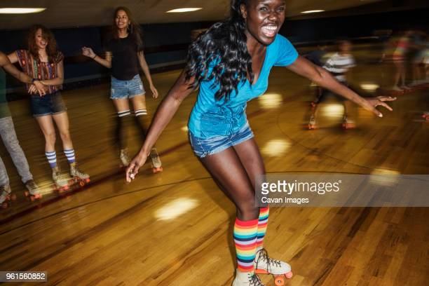 happy woman enjoying with friends at roller rink - roller rink stock photos and pictures
