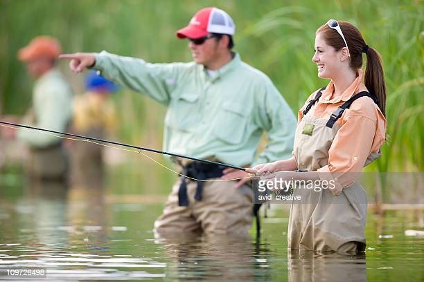 Happy Woman Fly Fishing While Male Points