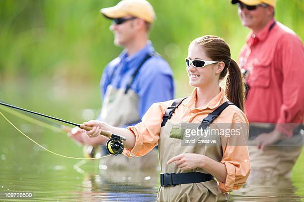Happy Woman Fly Fishing With Friends