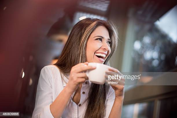 Happy woman having a cup of coffee