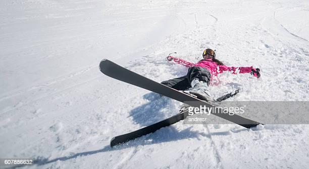 happy woman having fun skiing - lying down photos et images de collection