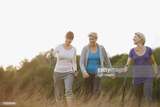 happy woman hiking together outdoors - baby boomer stock pictures, royalty-free photos & images