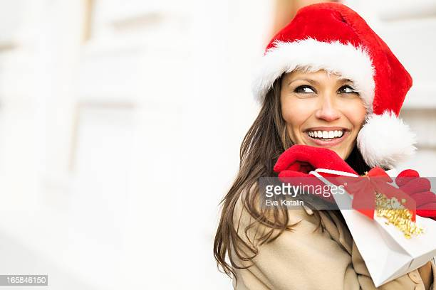Happy woman holding a Christmas present