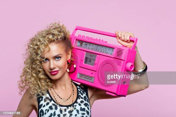 happy woman in 80's style outfit holding boom box - pop music stock pictures, royalty-free photos & images