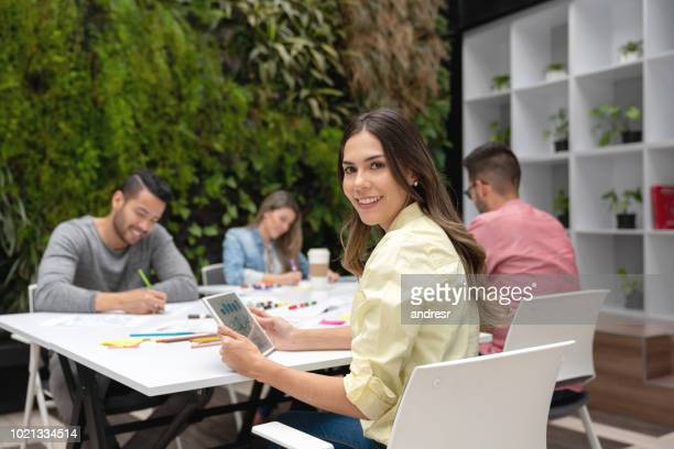 Happy woman in a business meeting at a creative office