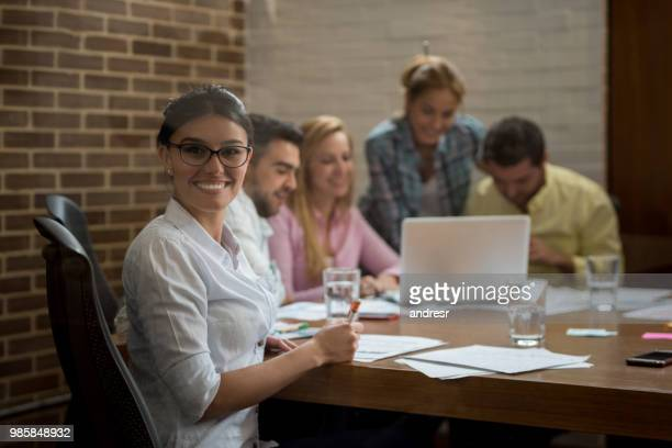 happy woman in a business meeting at the office - customer engagement stock pictures, royalty-free photos & images