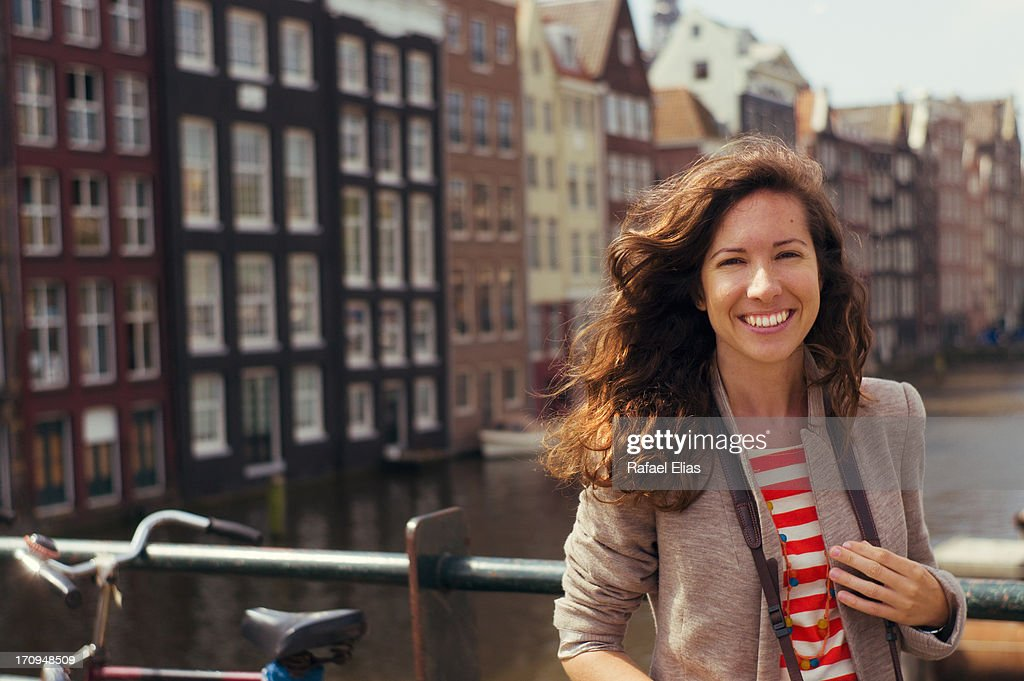 Happy woman in Amsterdam : Stock Photo