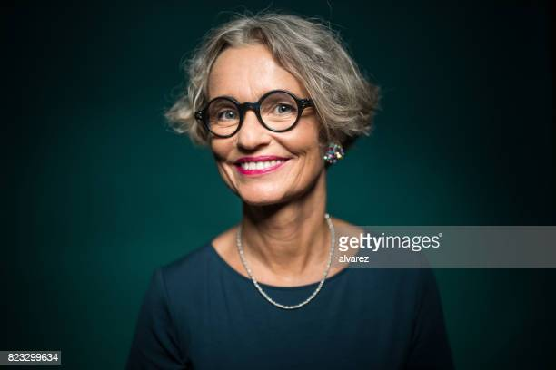 happy woman in eyeglasses against green background - pink lipstick stock photos and pictures