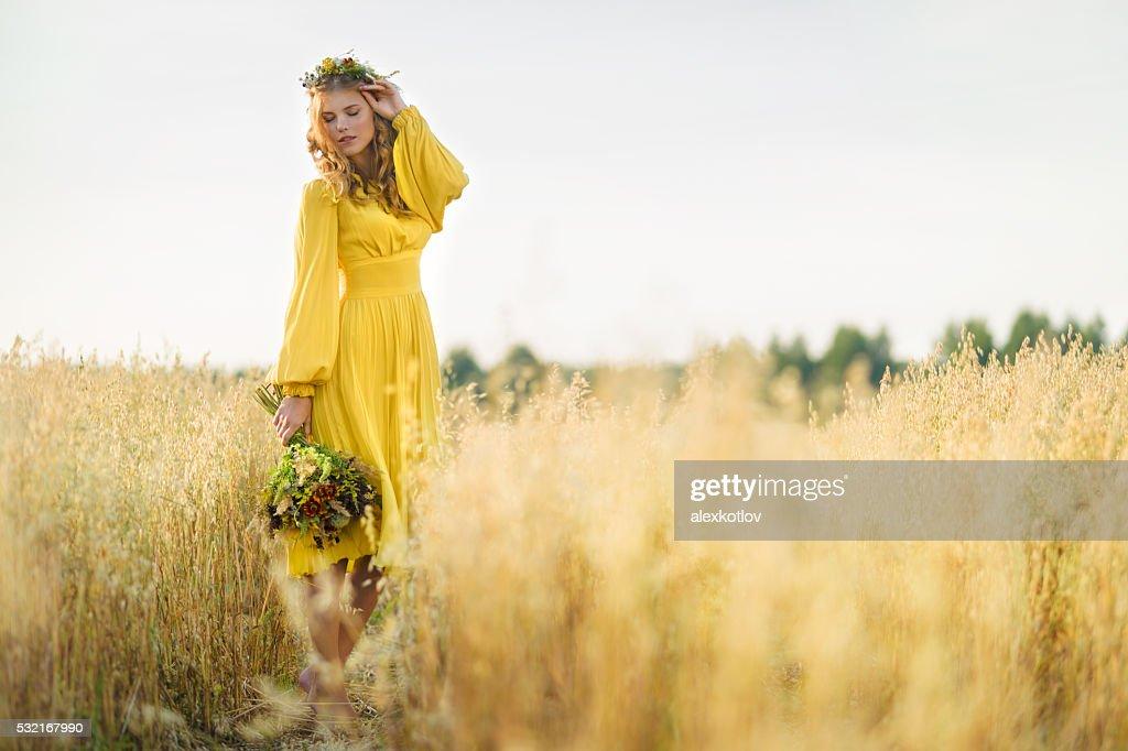Happy woman in fields : Stock Photo