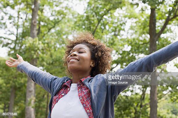 happy woman in forest - non urban scene stock pictures, royalty-free photos & images