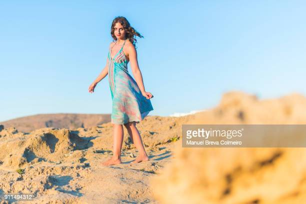 happy woman in greece - sleeveless stock photos and pictures