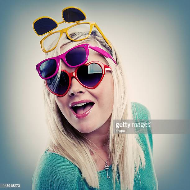 Happy woman in many sunglasses