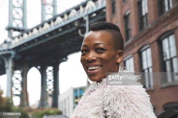 happy woman in new york city - brooklyn new york stock pictures, royalty-free photos & images