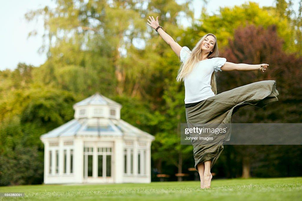 Happy woman in park : Stock Photo