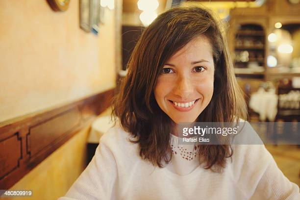 Happy woman in restaurant