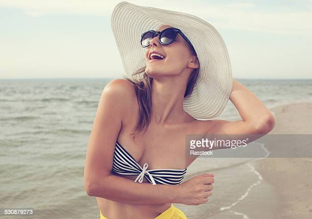 Happy woman in swim attire on the beach