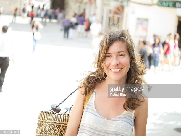 Happy woman in the street