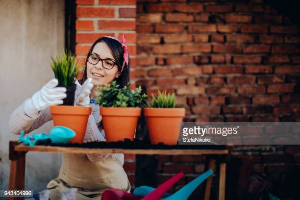 Happy woman in urban city garden