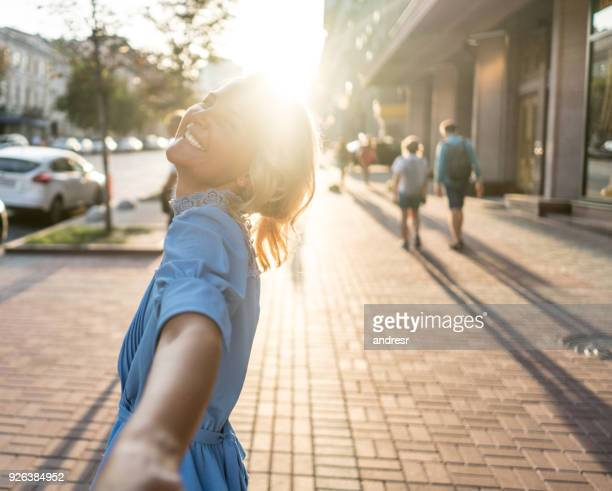 happy woman leading the way while traveling in london - following stock pictures, royalty-free photos & images