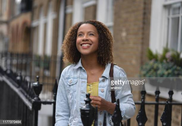 happy woman leaving her house to start a new day - gratitude stock pictures, royalty-free photos & images