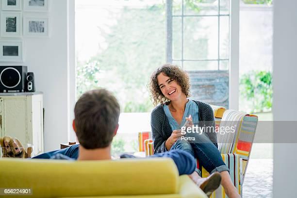 Happy woman looking at man.