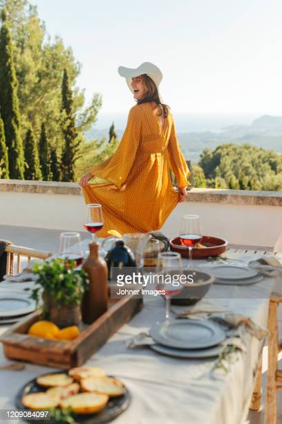 happy woman looking away - yellow dress stock pictures, royalty-free photos & images