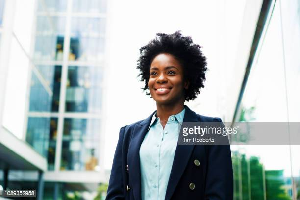 happy woman looking up - natural black hair stock pictures, royalty-free photos & images