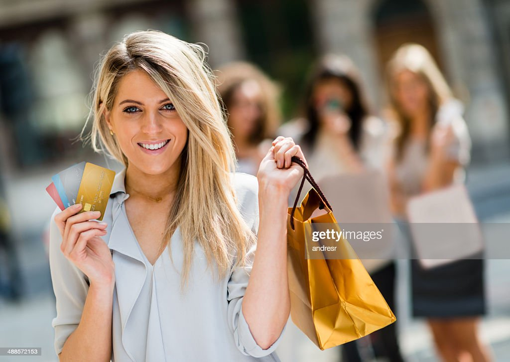Happy woman on a shopping spree : Stock Photo